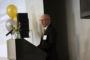 CU Provost Russ Moore speaks at the opening ceremony.