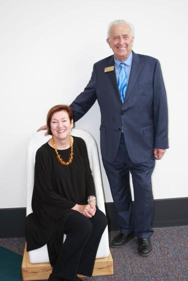 """Bob and Nancy Sievers, major donors, pose with the marble """"Lincoln chair"""" that Bob Sievers carved out of a piece of Colorado marble that had been a discarded scrap from the blocks of marble used to make the Lincoln memorial."""