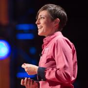 Woman presenting at a TED talk