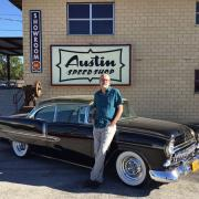 Neurosurgeon Dan Peterson displays his CU-themed black and gold 1955 Chevy outside of Austin Speed Shop.