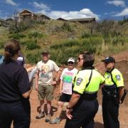"An official with the Colorado Springs Fire Department discusses fire mitigation with members of a neighborhood group. ""Citizen entrepreneurs"" helped the CSFD spread the word effectively about fire-mitigation practices after the 2012 Waldo Canyon fire, a CU-Boulder study has found. Photo courtesy of the Colorado Springs Fire Department."