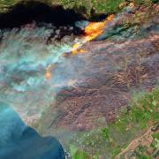 Satellites can quickly detect and monitor wildfires from space, like this 2017 fire that encroached on Ventura, California. NASA Earth Observatory/Joshua Stevens
