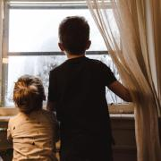 Kids looking out a window