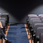 Two people sitting in an auditorium