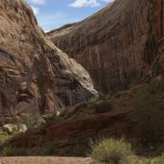 Black Dragon Canyon is deep, narrow and sinuous, and desert varnish darkens the walls.