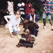 Lambert with a bushmeat vendor at the border of Cote d'ivoire and Liberia.  Photo courtesy of Joanna Lambert.