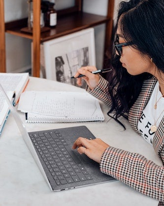 Woman looking at laptop on table