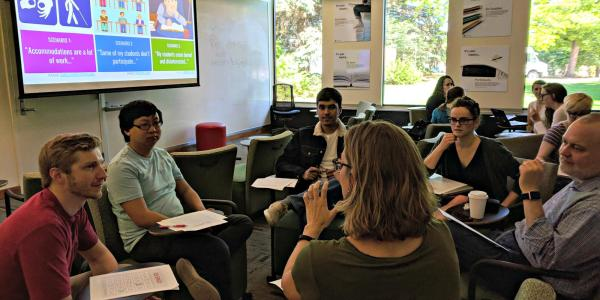 Participants in small groups discuss Universal Design for Learning