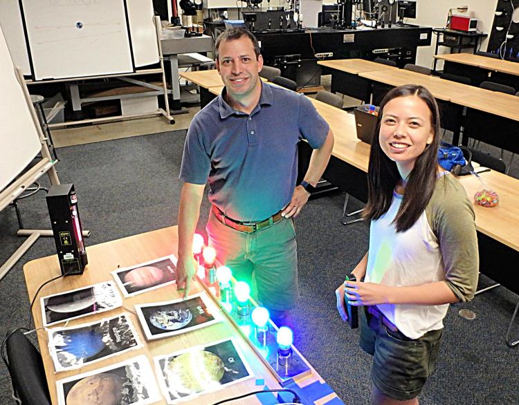 Seth Hornstein and Rachel Bowyer demonstrate the equipment used in the spectroscopy lab.