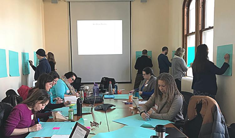 Faculty Fellows engaged in an interactive design session