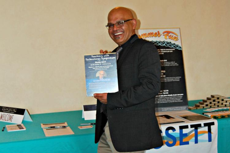 Punya Mishra poses with the flier announcing his keynote at the 2018 Teaching with Technology Symposium