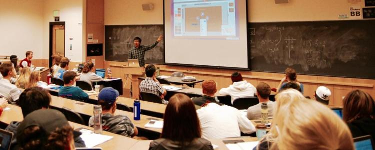 Austin Chau presents a technology to a class of students
