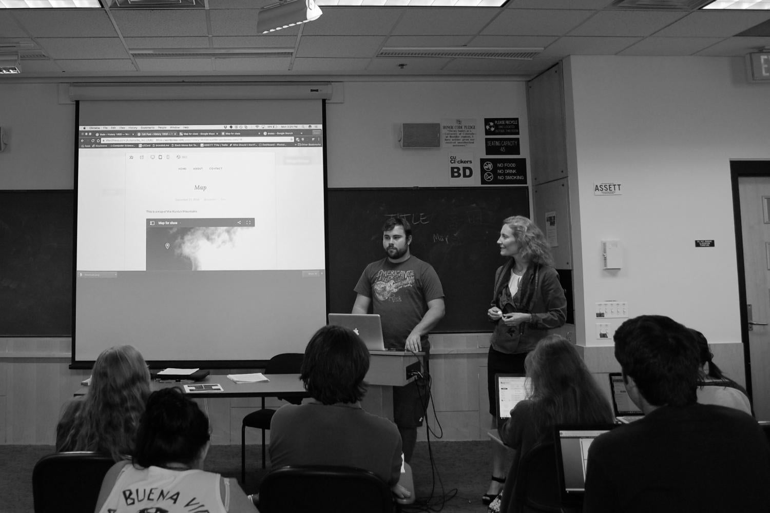 Dr. Anne Lester and Student Fellow Jake presenting to the class