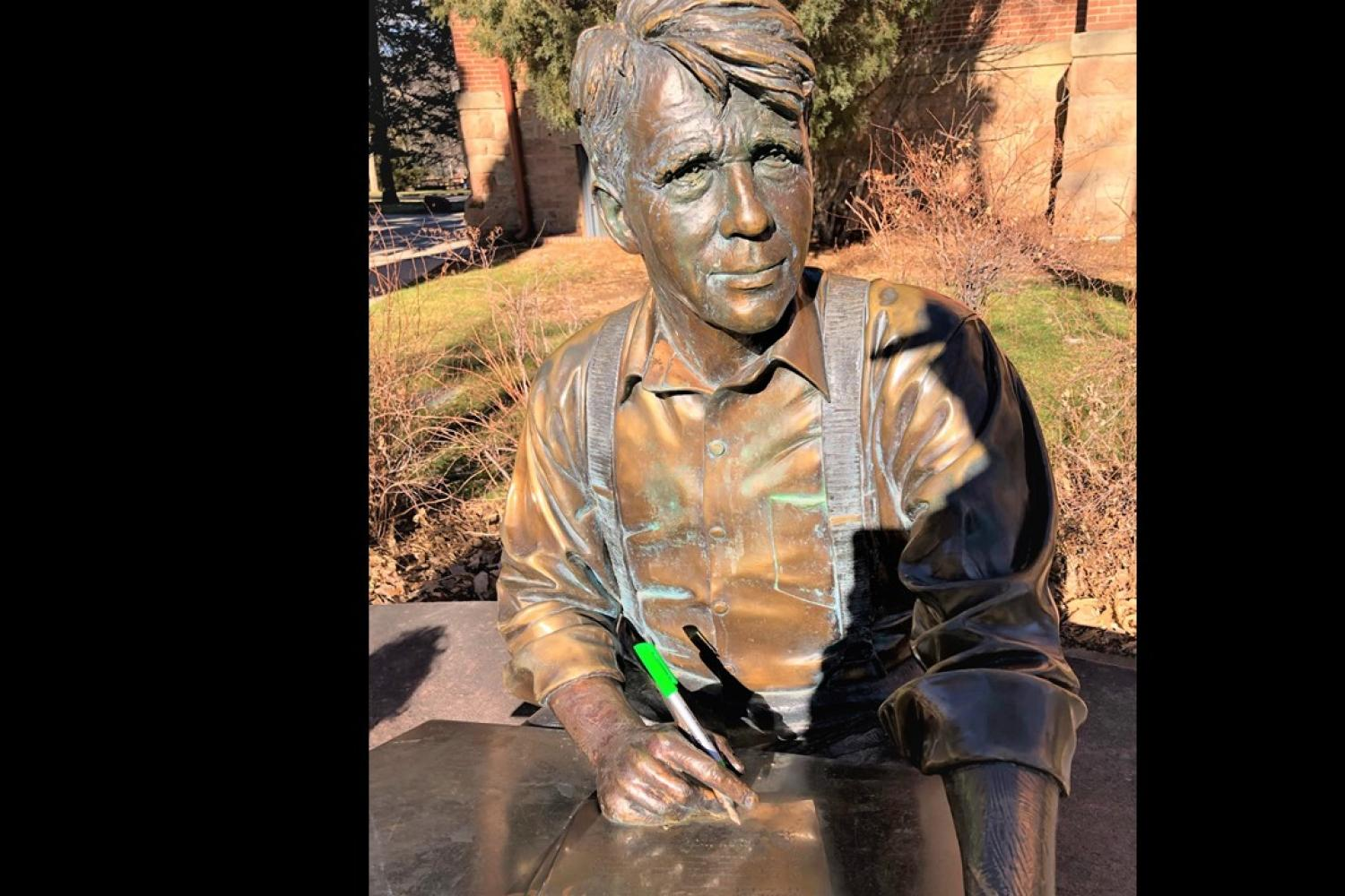 Statue of Robert Frost holding an ASSETT pen