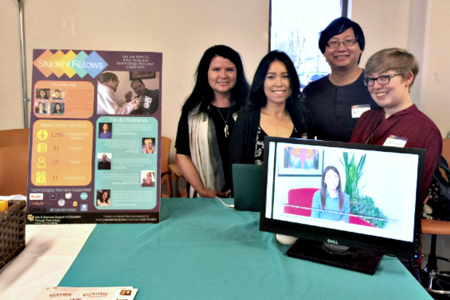 Student Fellows staffing an information booth at the 2018 ATDT Showcase