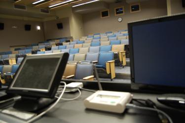 Large empty classroom with computer podium