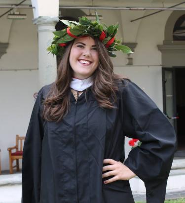 Sara Myers in graduation regalia
