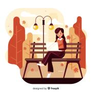 Cartoon of a woman using a laptop in a park during fall
