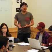 Student Technology Consultants Nicola Cave and Austin Chau provide a demonstration in class to students.