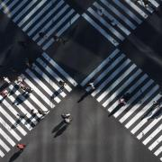 Pedestrians crossing two busy intersections.