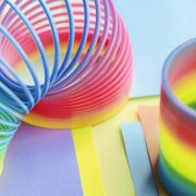 Photo of a rainbow colored slinky spring toy