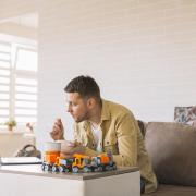 Father working from home with young child
