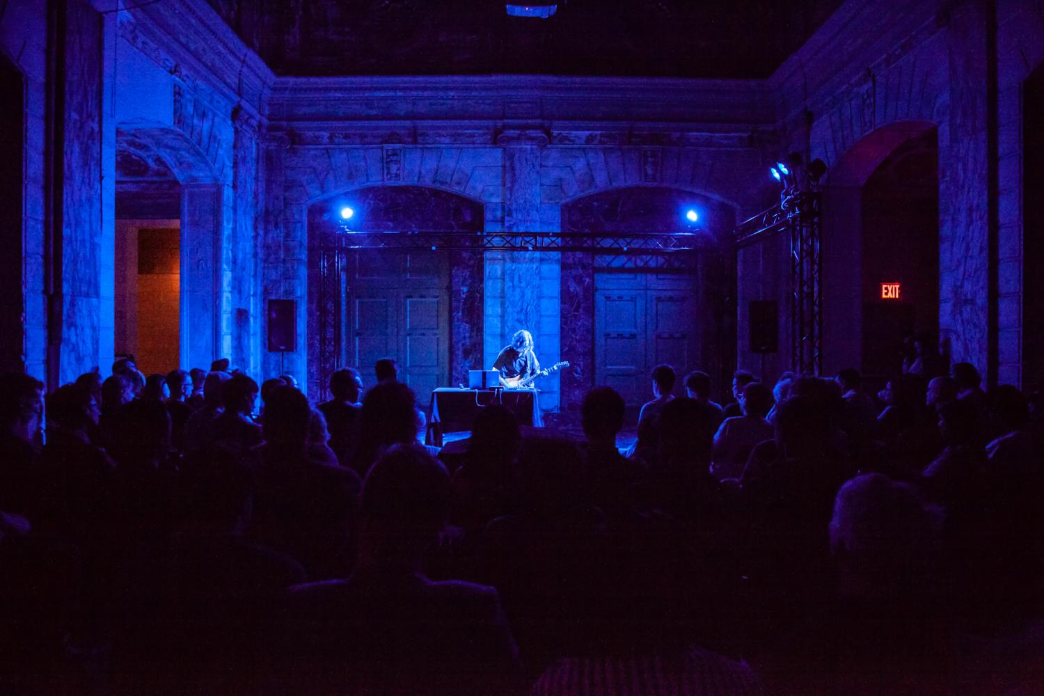 Michael Theodore plays electric guitar in a sold-out show at Issue Project Room in Brooklyn on June 26