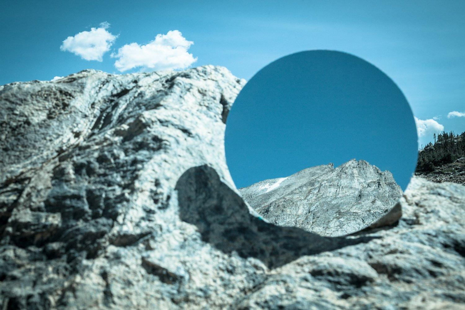 Kevin Hoth's photo of a mountain peak that also contains a circle with a closeup of the peak.