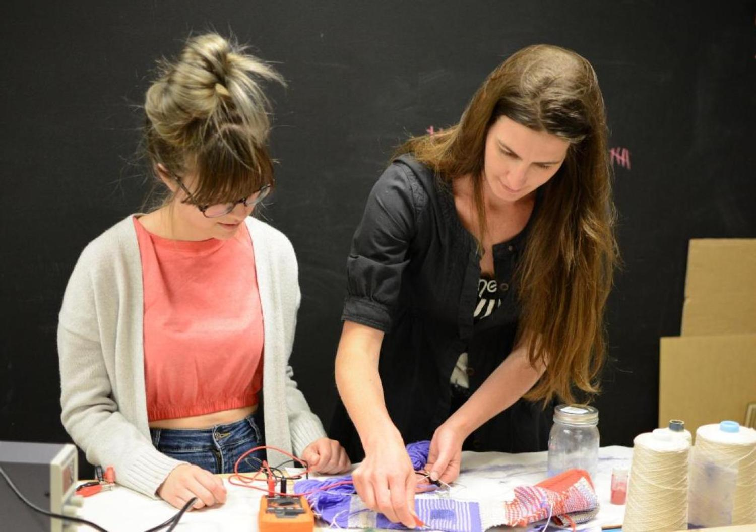Laura Devendorf works with a lab assistant in her Unstable Design Laboratory.
