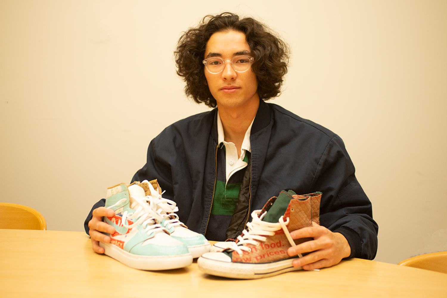 Toby Wu with handmade shoes, uppers made from recycled materials