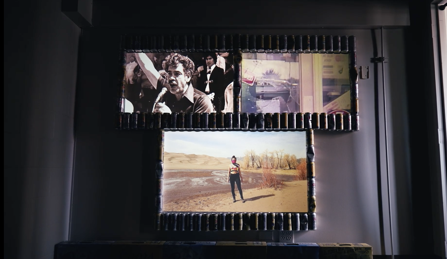 Andrea Fautheree Márquez's project with three screens all on their own loops and framed by Coors beer cans