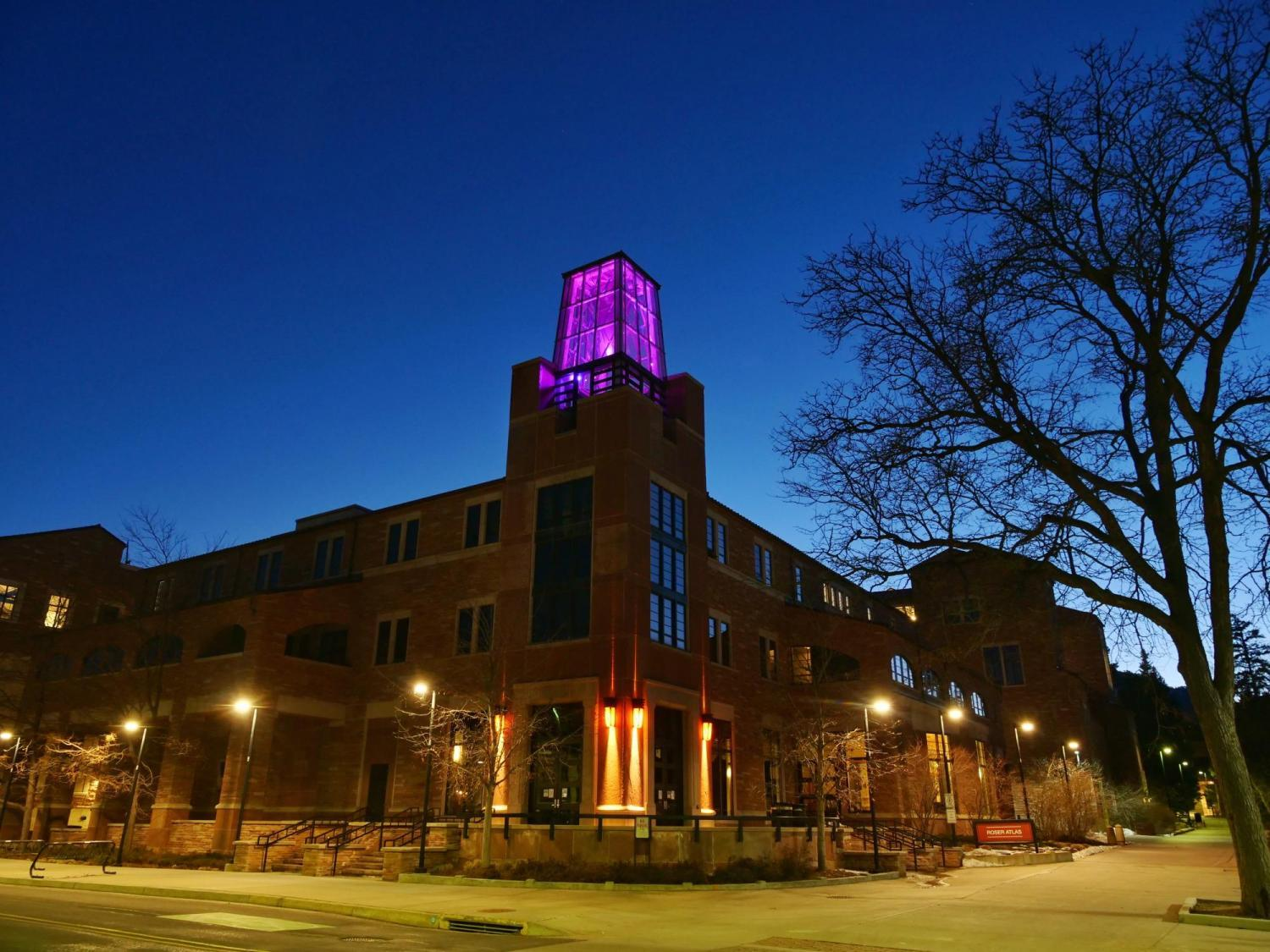 ATLAS building with a magenta-colored light display.