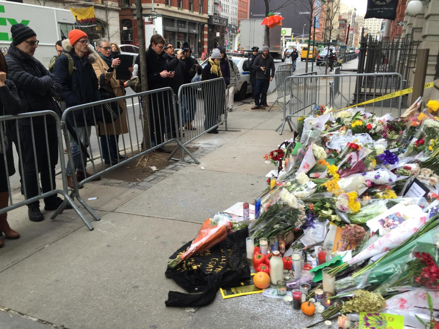 Photo of Bowie memorial and people taking photos