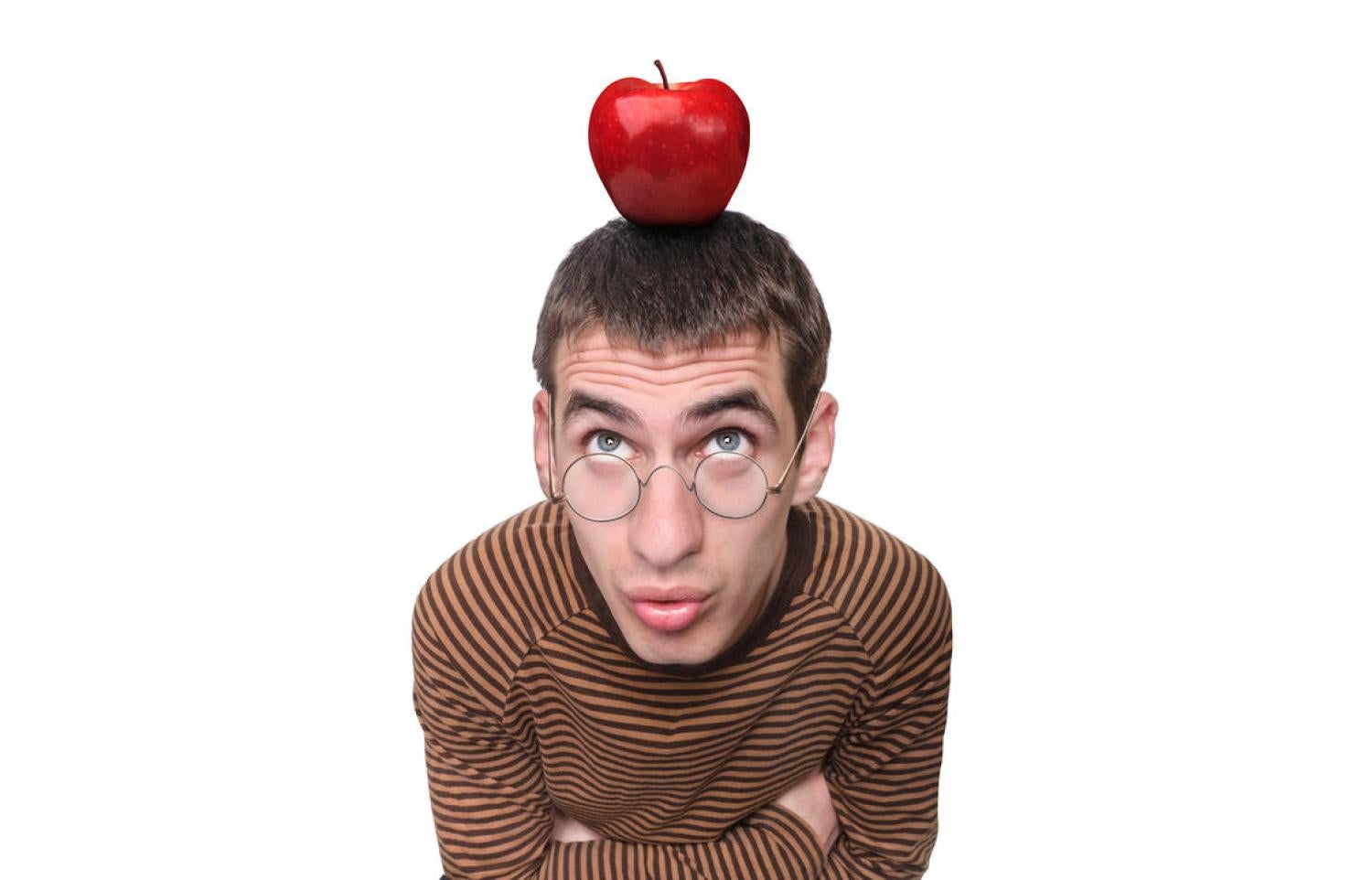 Photo of a man with an apple balanced on his head.