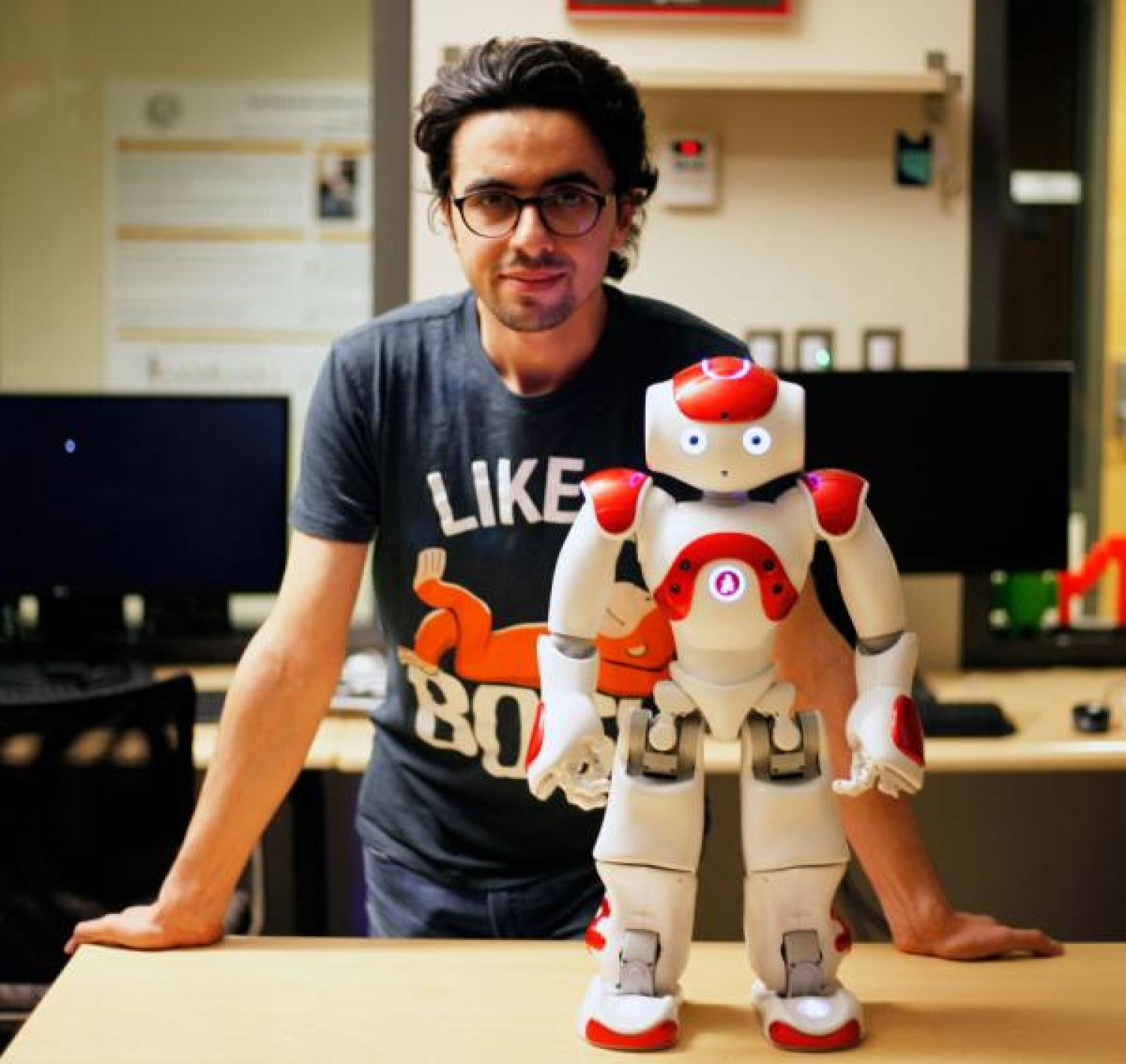 Photo of Hooman Hedayati with robot