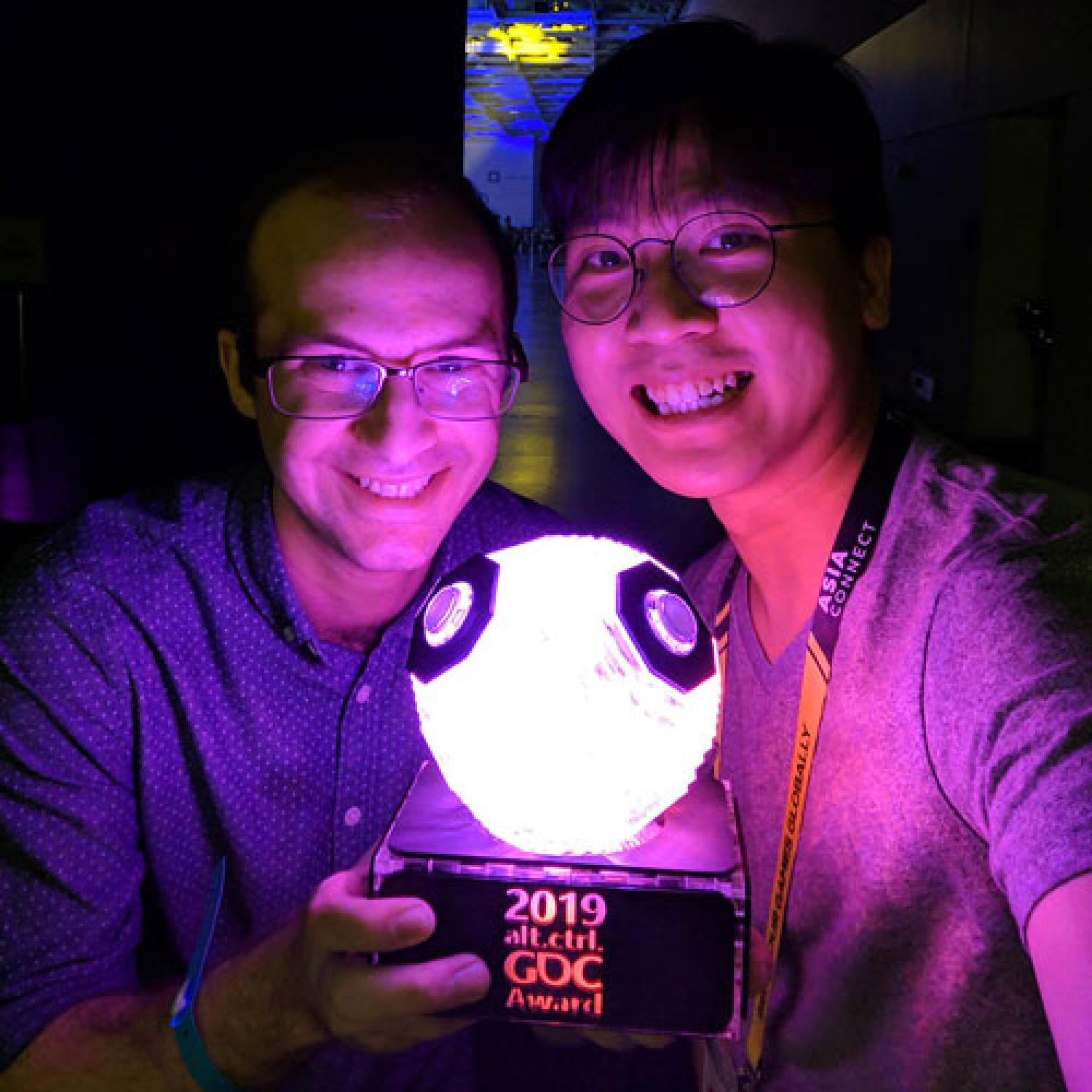 Clement and Zheng with award