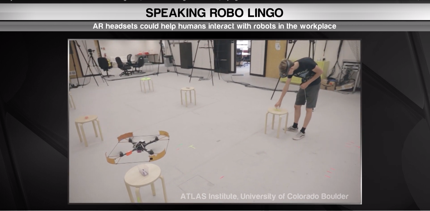 Research subject wearing augmented reality headset working with drone.
