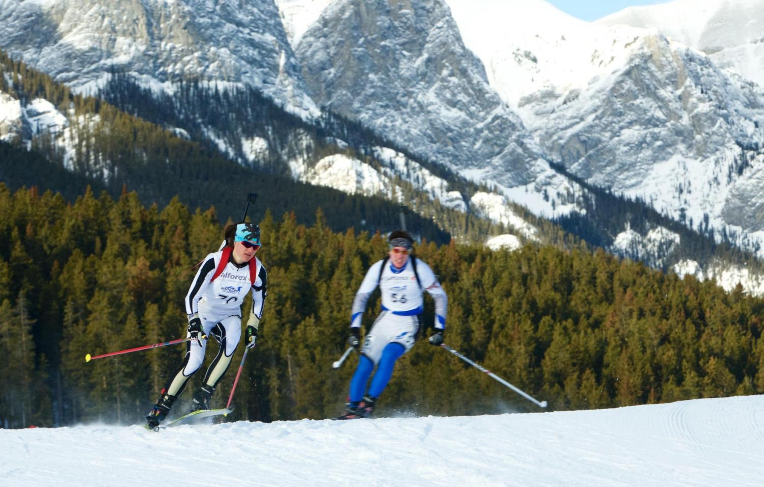 Photo of Joanna Reid skiing in mountains during biathlon