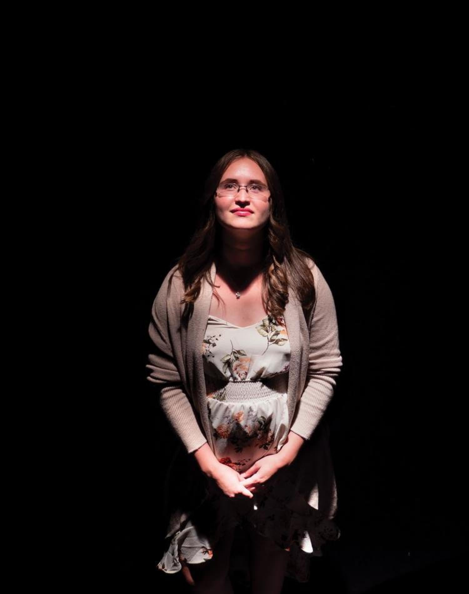 Photo of Michelle Galetti surrounded by darkness