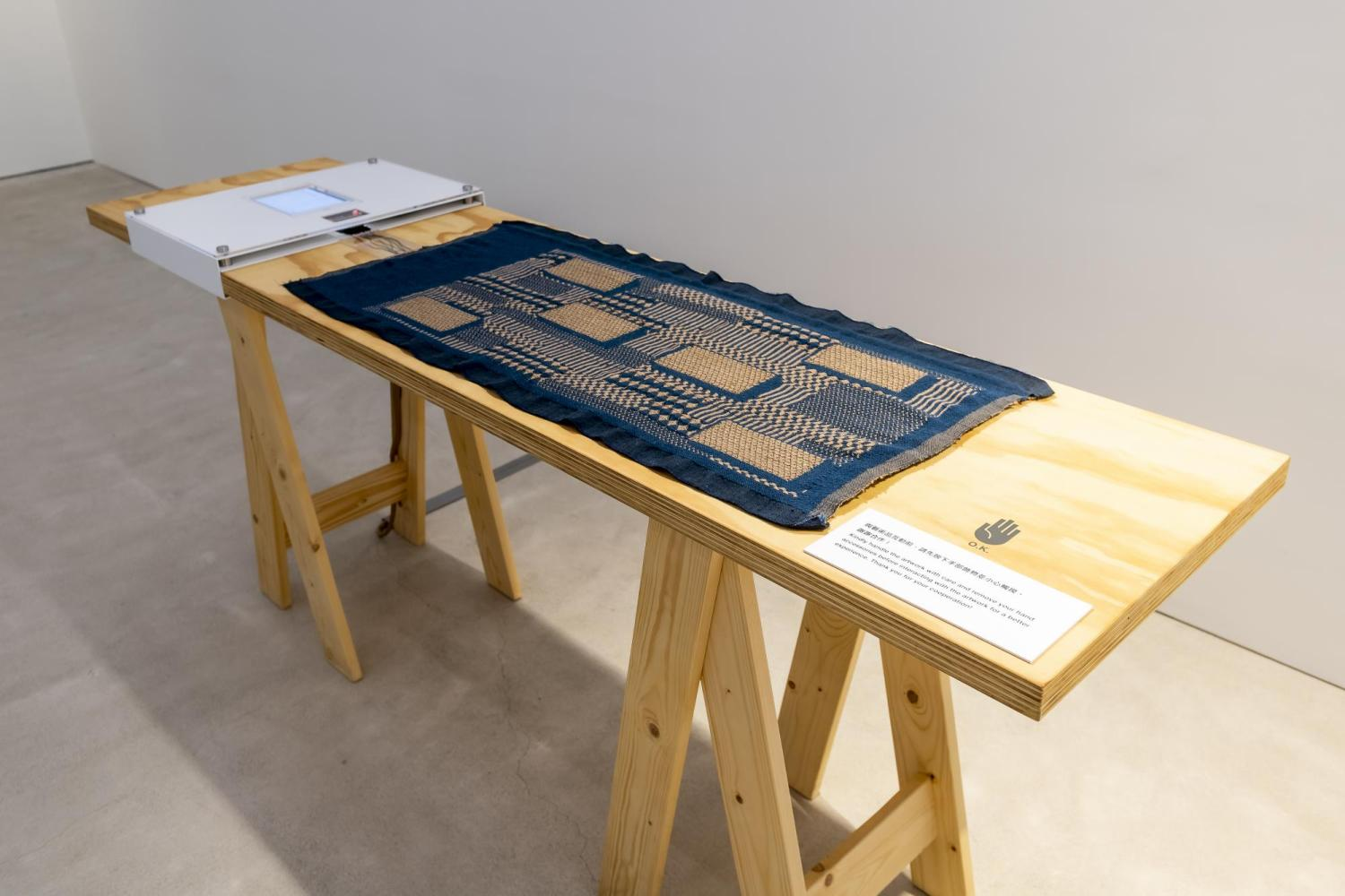 """""""A Fabric that Remembers"""" displayed on a table at the Centre for Heritage, Arts and Textile in Hong Kong"""
