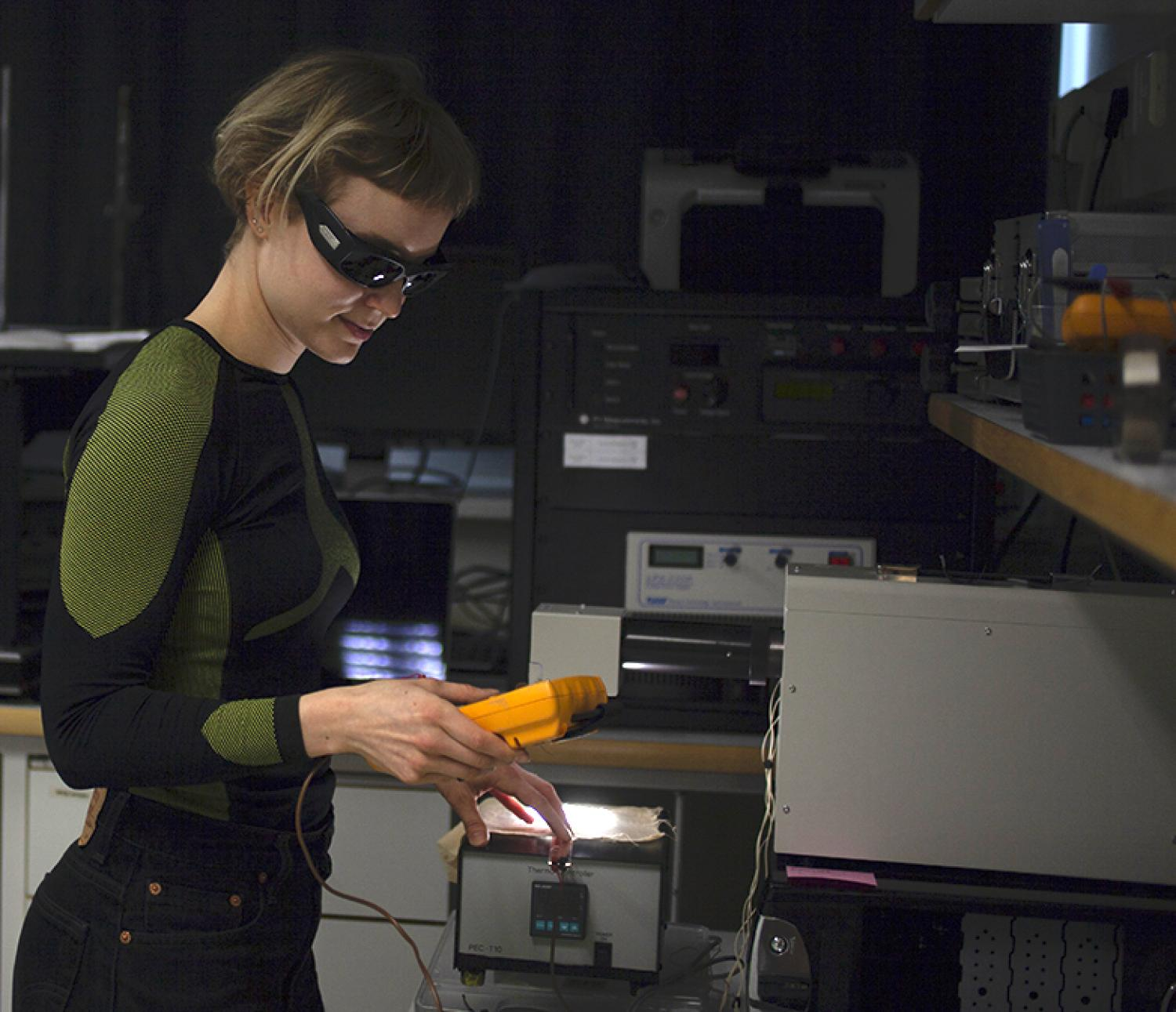 Sandra Wirtanen at Aalto University Department of Applied Physics laboratory measuring performance of textile prototypes.
