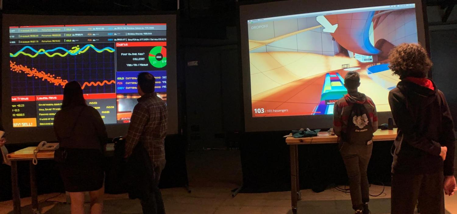 Whaaat!? Festival participants play video games on huge screens.