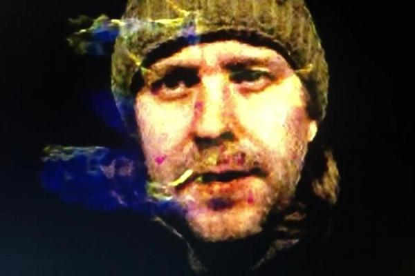 headshot of brad gallagher wearing a hat and surrounded by smoke