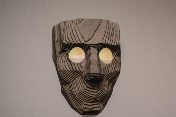 Photo of face made out of layered cut cardboard