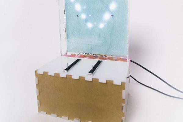 Photo of lit up laser-cut acrylic box