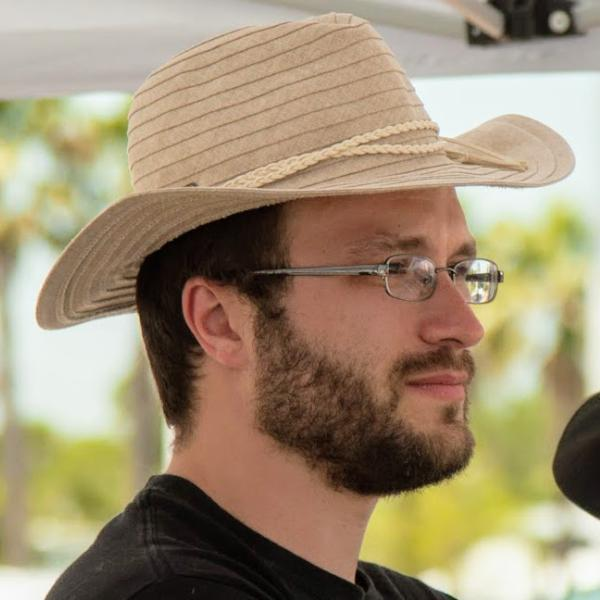 Daniel Koris with a sun hat.