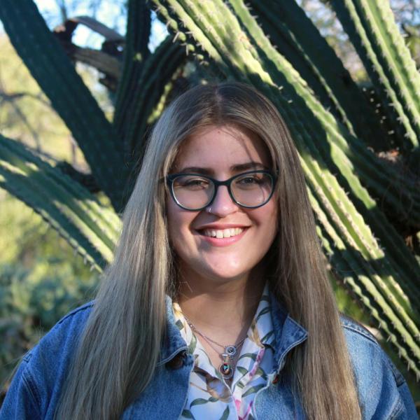 Priyanka Makin in front of some large cactus.