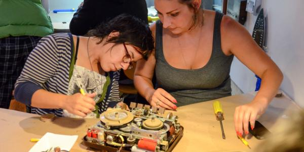 Women working with electronics