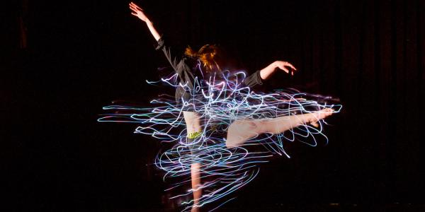 Emily Daub performs a modern dance while wearing LED-lighted outfits that she designed and constructed herself.