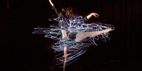 Photo of Emily Daub dancing in her wearable technology